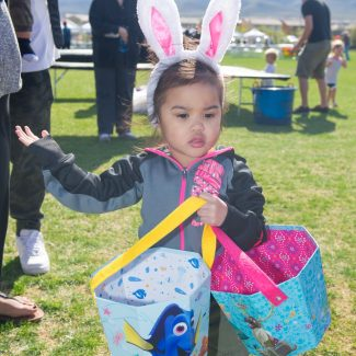 girl dressed for easter egg hunt