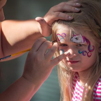 girl getting unicorn face painting