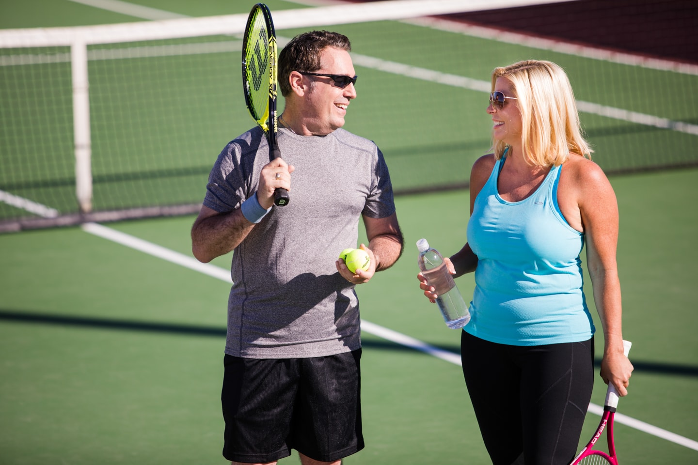 A man and woman converse with each other during a Pickleball tournament.