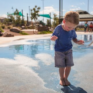 boy playing in splash pad