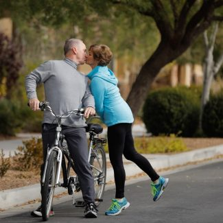 couple kissing while on tandem bike ride