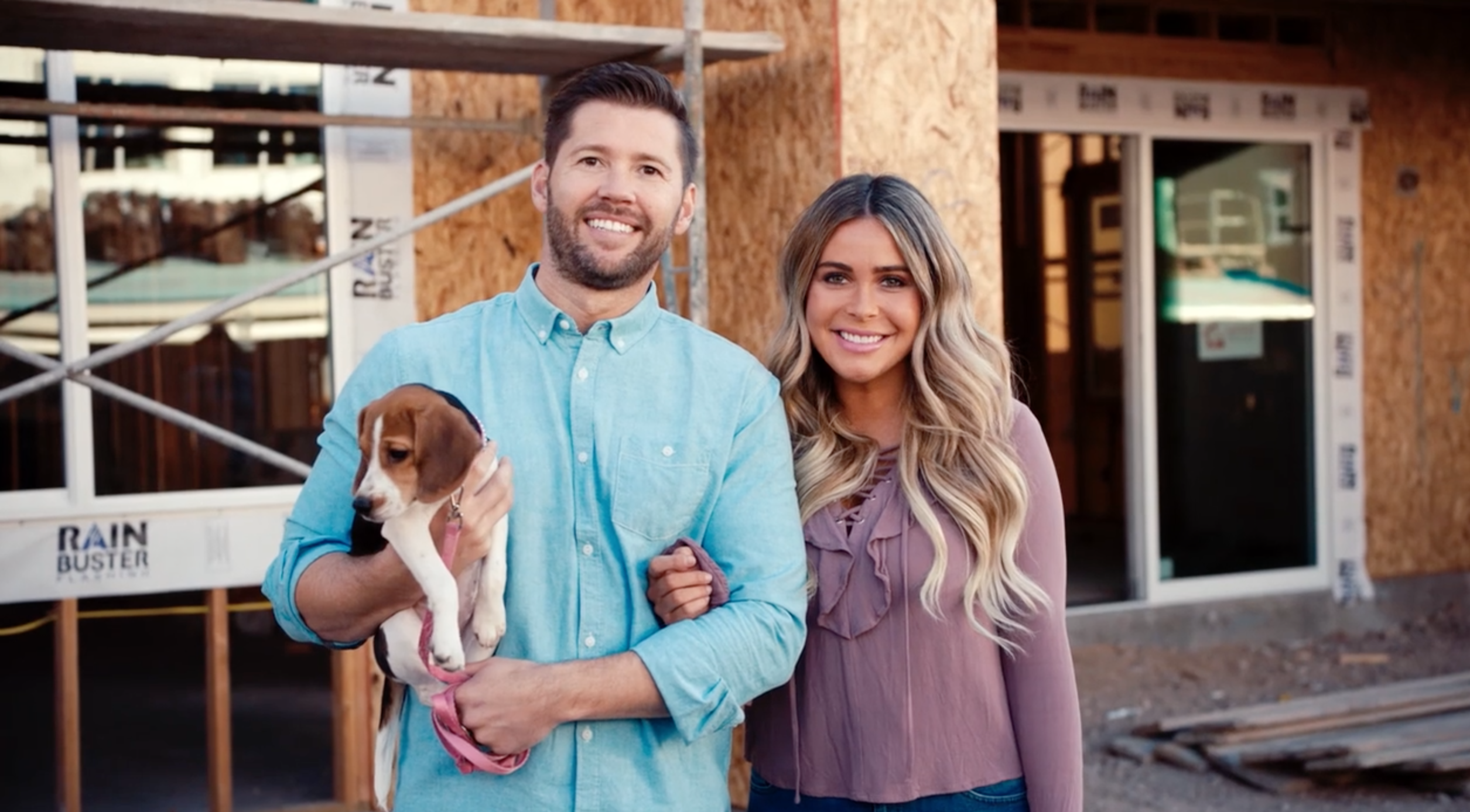 couple in front of home construction