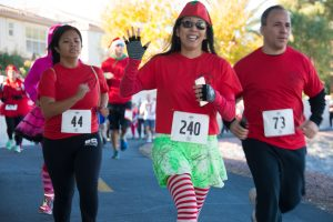 Runners dressed in festive costumes during the Riendeer Dash 5K