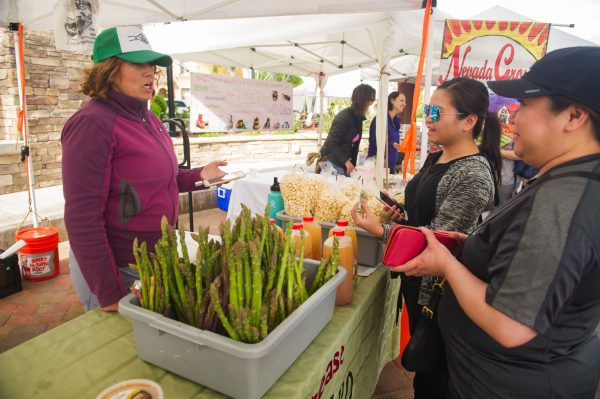buying asparagus from a farmers market