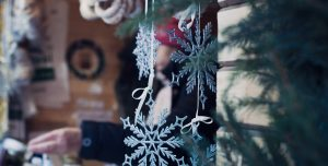 Blue snowflakes hang from a string at the Holiday Vintage Market & Craft Sale
