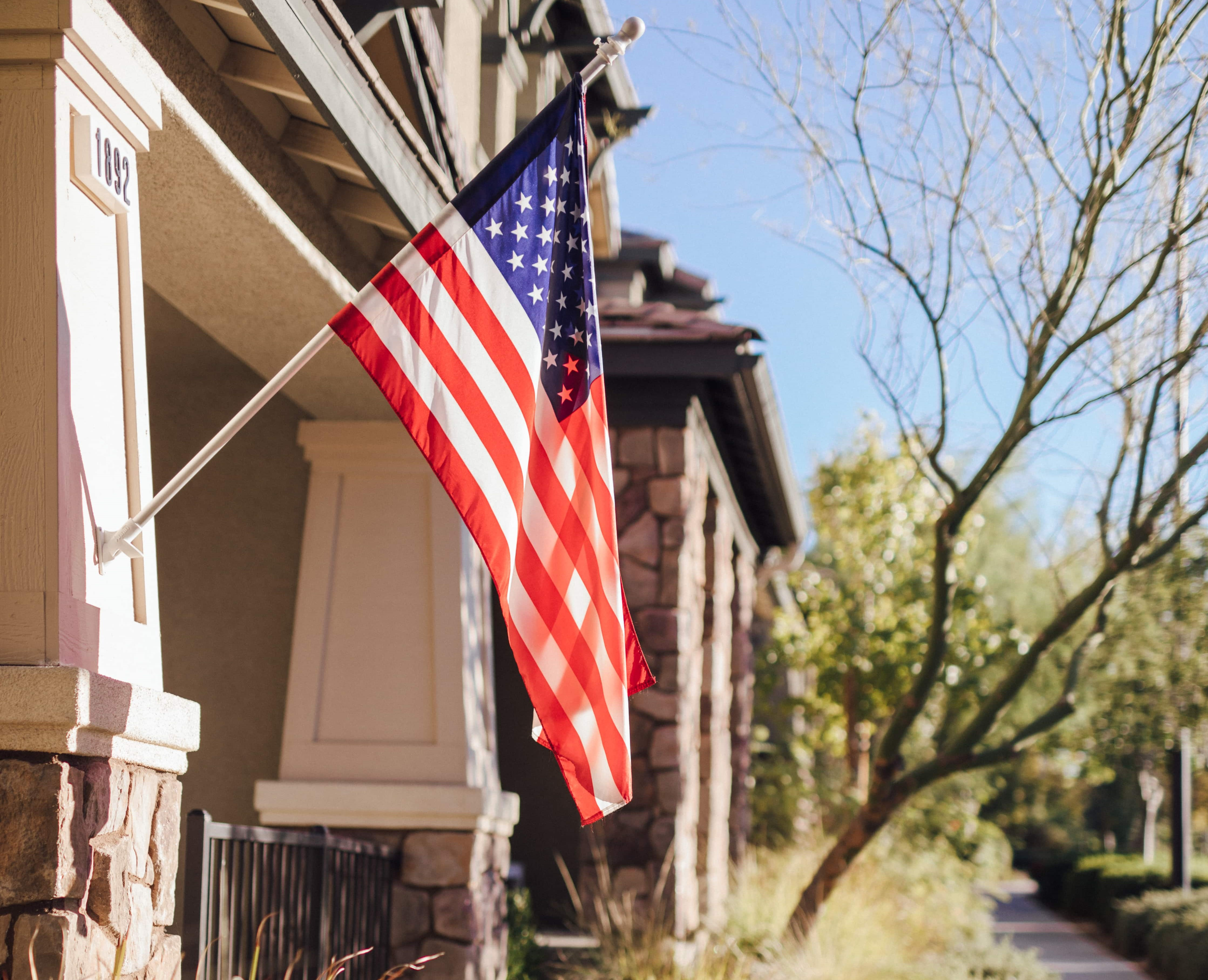 american flag hanging outside townhome