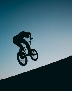 Man jumping on a bike.