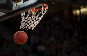 A basketball fall through the net of a basketball hoop