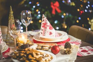 White dinner plate with festive holiday napkin placed on top