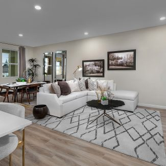 Open floor plan living room with white furniture.
