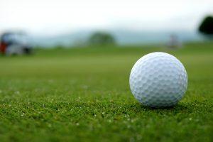 A golf ball sits on green grass