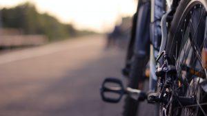 A close-up of a bike on a street.
