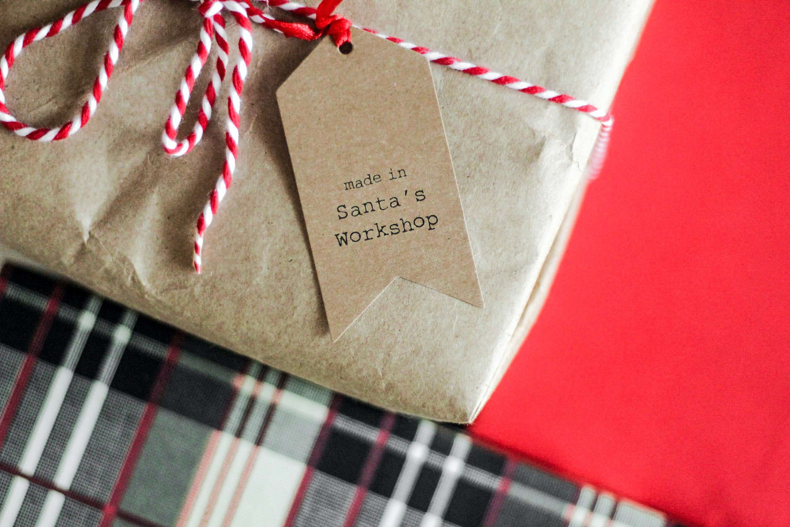 A box with a tag that says made in Santa's workshop.