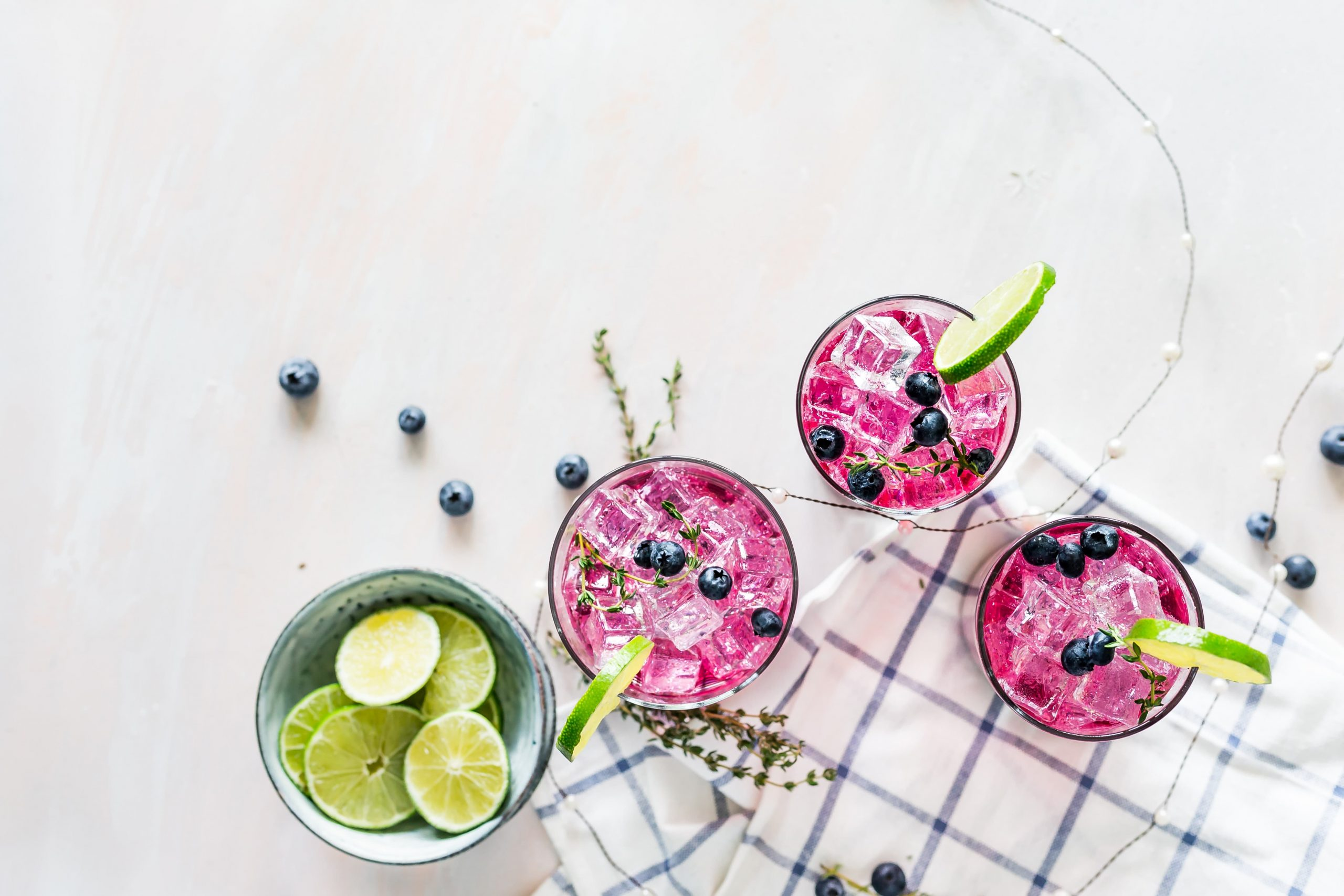 Three colorful drinks on a white background.