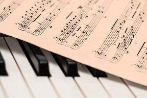 A sheet of music on piano keys