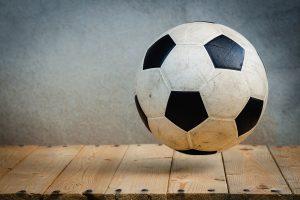 A soccer ball on a wooden floor